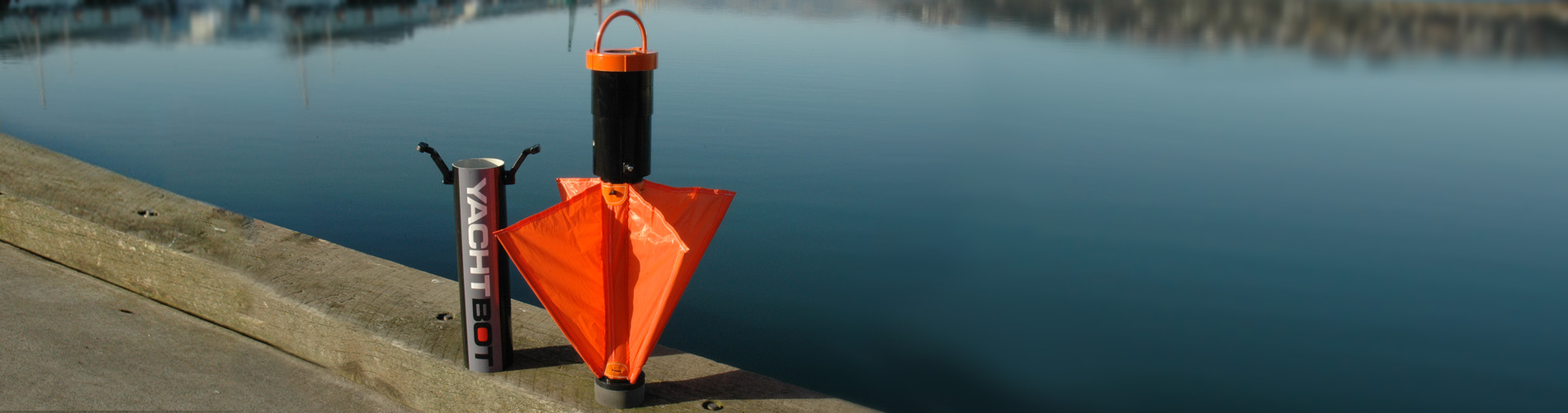 WindBot attached to a boat floating in a calm harbour