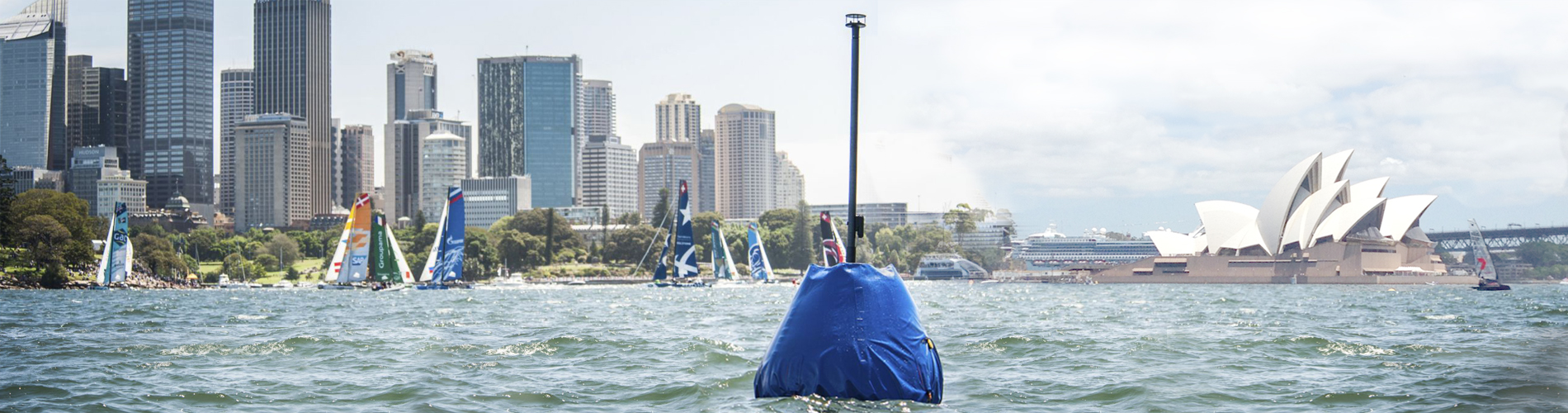 WindBot on a buoy during a race with Sydney Opera House in the background